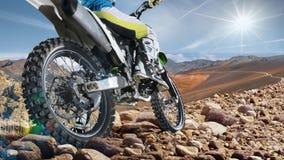 Professional dirt bike rider on top of vulcan closeup Royalty Free Stock Images