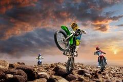 Professional dirt bike riders on top of vulcan Stock Photo