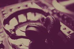 Professional dj headphones on sound mixer in club Royalty Free Stock Photos