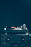 Professional dj turntable on flight case, dark background Royalty Free Stock Photo