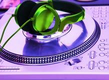 Professional DJ Vinyl Player. With green Headphones on it stock photos