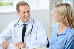 Professional doctor examining his patient Royalty Free Stock Image