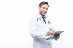 Professional doctor filling the papers Stock Images