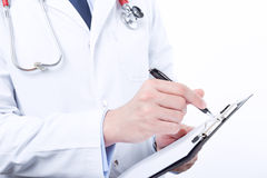 Professional doctor filling the papers Stock Photo