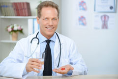 Professional doctor giving pills Stock Image