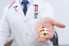 Professional doctor giving pills Stock Photo