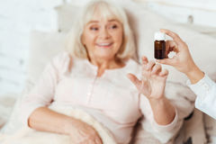 Professional doctor giving pills to an old woman Royalty Free Stock Photos