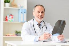 Professional doctor holding radiogram Stock Photos