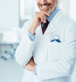 Professional doctor posing at hospital Stock Photo