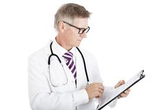 Professional Doctor Seriously Reading Records Royalty Free Stock Photography