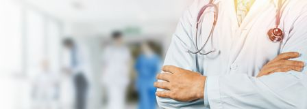 Professional Doctor With Stethoscope In Hospital. Healthcare Medicine Concept