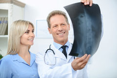 Professional doctor talking with his patient Royalty Free Stock Photo
