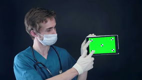 Professional doctor working with x-ray scan and tablet with green screen. HD stock video footage