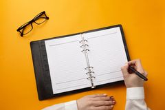 Professional doctor writing medical records in a notebook royalty free stock images