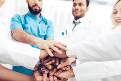 Professional Doctors Holding Each Other Hands. stock photos