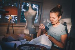 Professional dressmaker, designer making a costume at atelier. Professional dressmaker, designer making a cose at atelier. Fashion and tailoring concept stock image