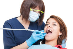 Professional drilling procedure at dentist on white background Stock Image