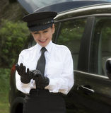 Professional driver putting on her driving gloves Royalty Free Stock Image