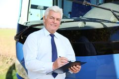 Free Professional Driver With Clipboard Near Bus Stock Photo - 130500230