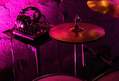 Professional drum kit and headphones on stage in night club stock photo