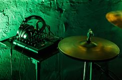 Professional drum kit and headphones on stage in night club stock photography