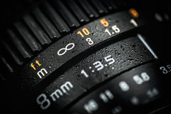 Professional DSLR lens on dark background. Macro photo Stock Photos