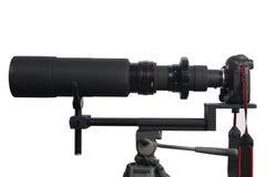Professional DSLR with Telephoto lens. On white background Stock Photos