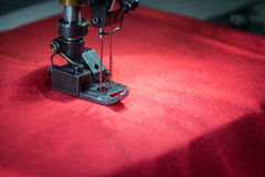 Professional dual needle sewing machine with red fabric. Dual needle sewing machine with red fabric Stock Photography
