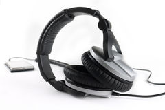 Professional earphones with a player. On a white background Stock Photos
