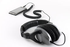 Professional earphones with a player. On a white background Royalty Free Stock Photos