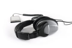 Professional earphones with a player. On a white background Stock Photography