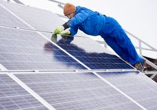 Professional electrician worker installing solar panels stock images