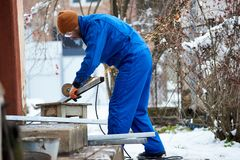 Professional electrician worker installing solar panels. Full length shot of a electrician technician working outdoors installing solar panels profession Royalty Free Stock Photo