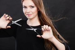 Professional elegant female barber with scissors. Stock Photography