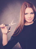 Professional elegant female barber with scissors. Royalty Free Stock Photos