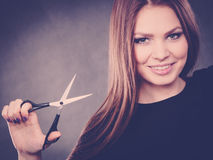 Professional elegant female barber with scissors. Stock Photos
