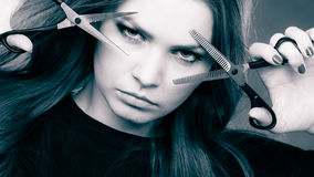 Professional elegant female barber with scissors. Royalty Free Stock Photo