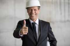 Professional engineer in hard hat showing thumb up Royalty Free Stock Image