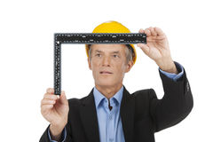 Professional engineer holding meter and thinking. Royalty Free Stock Photos