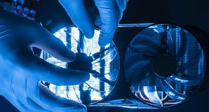 Professional engineer in laboratory working with micro electronic cooler fan f royalty free stock image