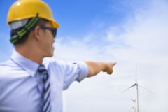 Professional engineer point the wind generator Stock Photo