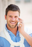 Professional entrepreneur talking on cell phone. Young professional entrepreneur talking on cell phone. Confident, happy, and successful Royalty Free Stock Image