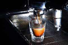 Professional espresso machine brewing a coffee Royalty Free Stock Photo