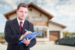 Professional estate seller with clipboard Stock Photography