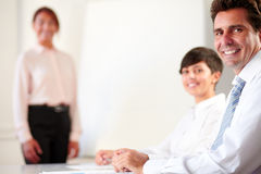 Professional executive group smiling at you royalty free stock photos