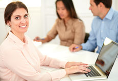 Professional executive woman smiling at you Stock Images