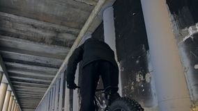 Professional extreme sportsman biker riding fat bike in outdoor. Close-up view of rear wheel. Cyclist ride in winter