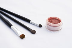 Professional eye shadows with make-up brushes Stock Image