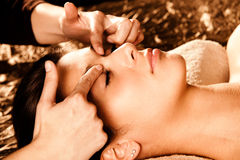 Professional face massage. Woman receiving professional face massage in spa salon Royalty Free Stock Photography
