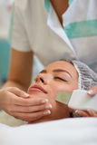 Professional facial treatment. With ultrasonic equipment for peeling skin Royalty Free Stock Photography